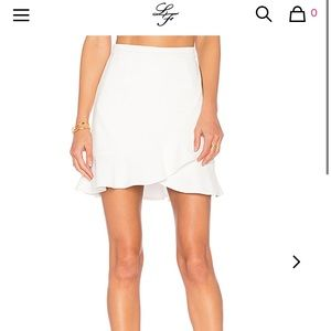 Lovers + friends white ruffle skirt. NWT! Size Sm